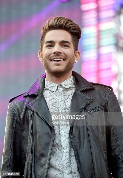 Singer Adam Lambert introduces Sia onstage during 1027 KIIS FM's 2015 Wango Tango at StubHub Center on May 9 2015 in Los Angeles California