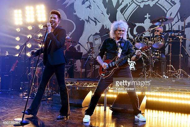 Singer Adam Lambert musicians Brian May and Roger Taylor perform onstage during Queen Adam Lambert for iHeartRadio Live at the iHeartRadio Theater on...