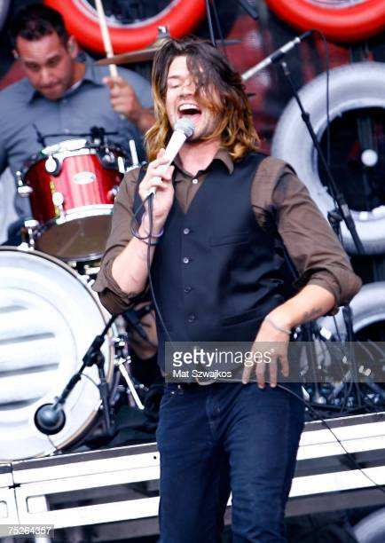 Singer Adam Lazzara of 'Taking Back Sunday' and drummer Mark O'Connell perform onstage during Live Earth New York at Giants Stadium on July 7 2007 in...