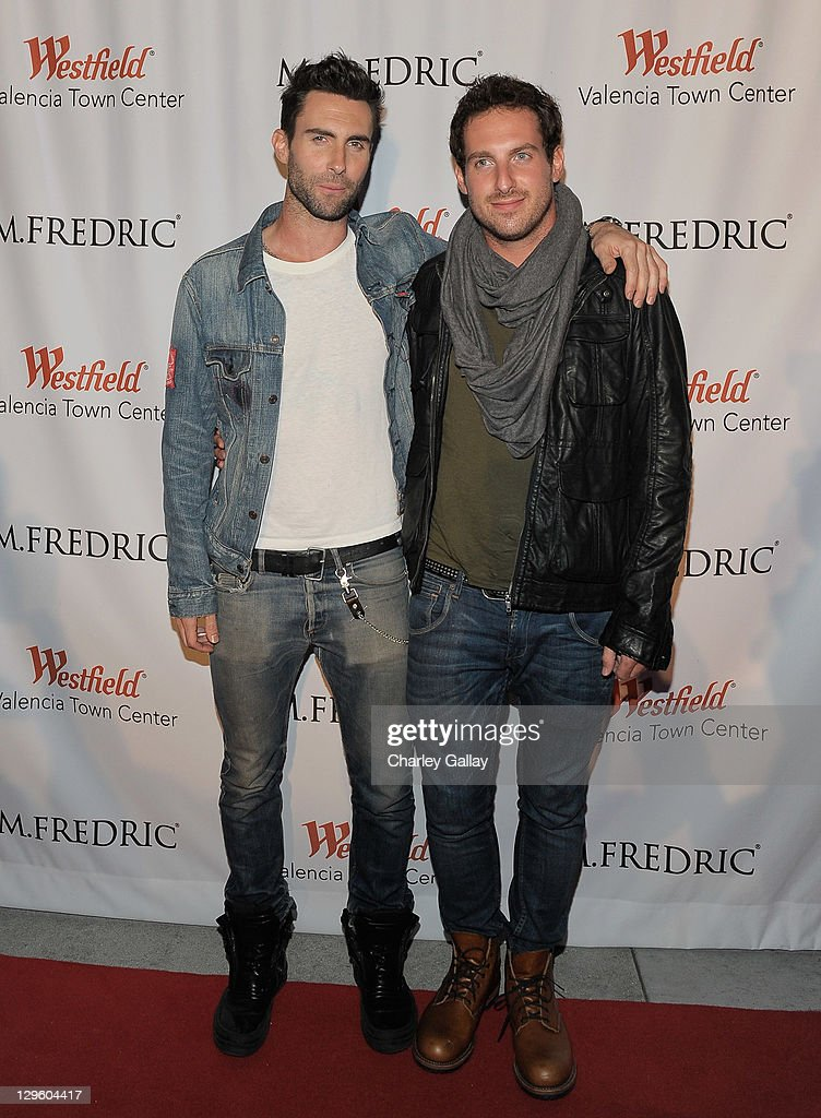 Singer <a gi-track='captionPersonalityLinkClicked' href=/galleries/search?phrase=Adam+Levine+-+Singer&family=editorial&specificpeople=202962 ng-click='$event.stopPropagation()'>Adam Levine</a> (L) and brother Michael Levine attend the grand opening of M. Fredric at Westfield Valencia Town Center on October 18, 2011 in Valencia, California.