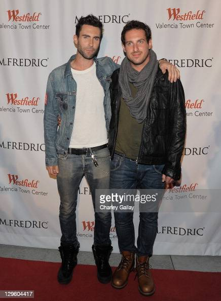 Singer Adam Levine and brother Michael Levine attend the grand opening of M Fredric at Westfield Valencia Town Center on October 18 2011 in Valencia...