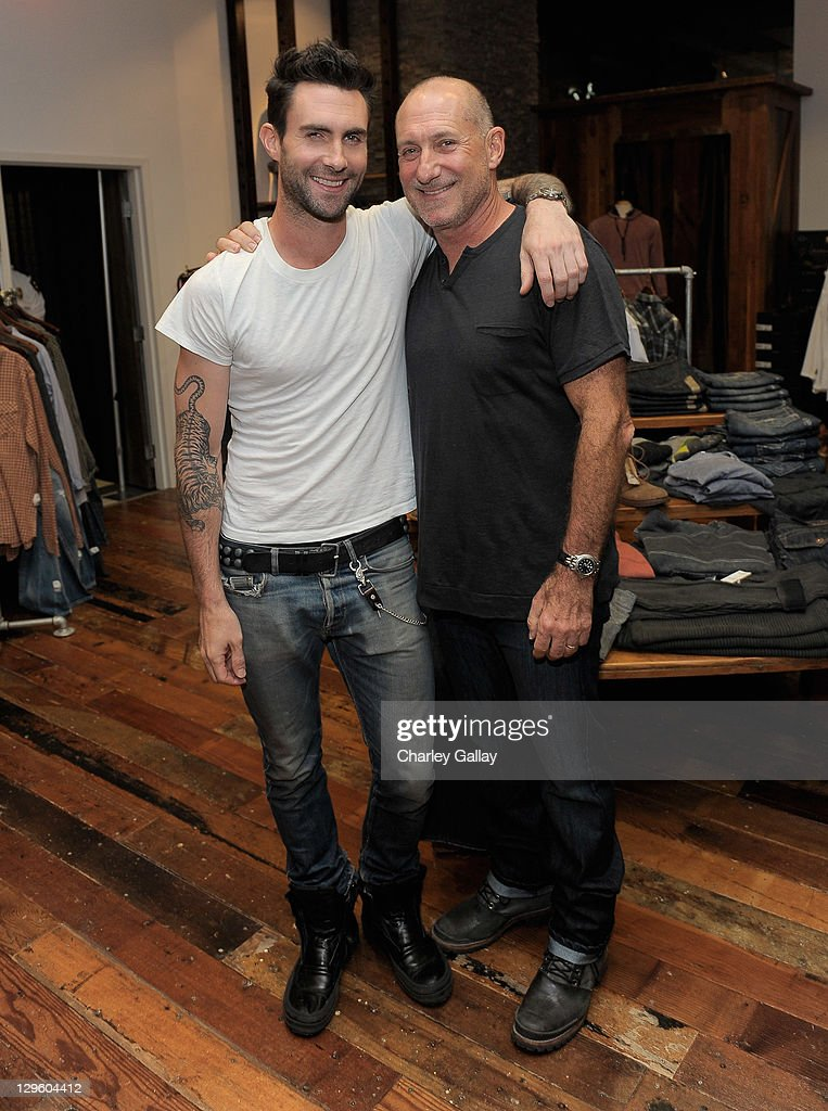 Singer <a gi-track='captionPersonalityLinkClicked' href=/galleries/search?phrase=Adam+Levine+-+Singer&family=editorial&specificpeople=202962 ng-click='$event.stopPropagation()'>Adam Levine</a> (L) and M. Fredric co-owner Fred Levine attend the grand opening of M. Fredric at Westfield Valencia Town Center on October 18, 2011 in Valencia, California.