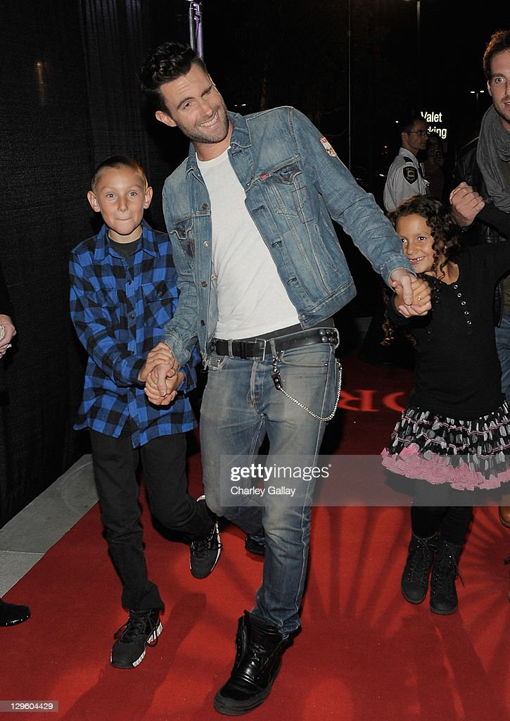 Singer <a gi-track='captionPersonalityLinkClicked' href=/galleries/search?phrase=Adam+Levine+-+Singer&family=editorial&specificpeople=202962 ng-click='$event.stopPropagation()'>Adam Levine</a> (C) attends the grand opening of M. Fredric at Westfield Valencia Town Center on October 18, 2011 in Valencia, California.