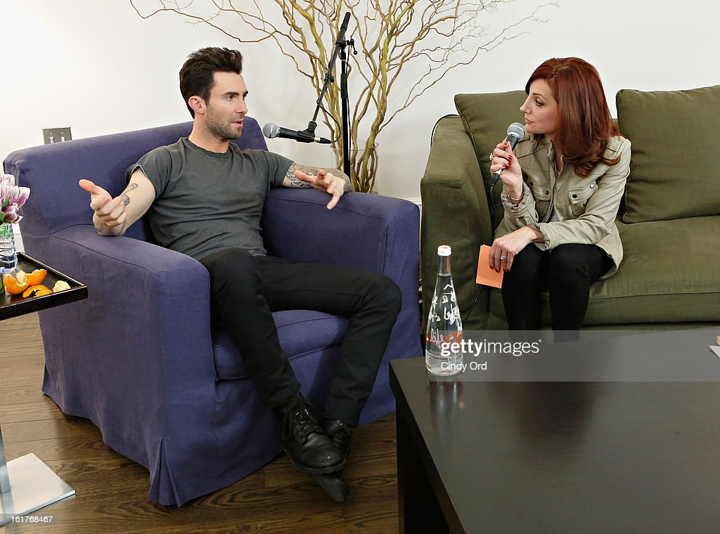 Singer Adam Levine (L) is interviewed exclusively by Danielle Monaro (R) of 'Elvis Duran and the Morning Show' at The Mercer Hotel on February 15, 2013 in New York City.