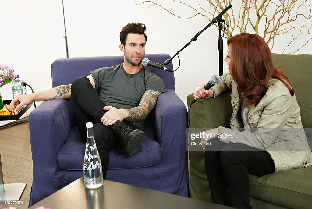 Singer <a gi-track='captionPersonalityLinkClicked' href=/galleries/search?phrase=Adam+Levine+-+Singer&family=editorial&specificpeople=202962 ng-click='$event.stopPropagation()'>Adam Levine</a> (L) is interviewed exclusively by Danielle Monaro (R) of 'Elvis Duran and the Morning Show' at The Mercer Hotel on February 15, 2013 in New York City.