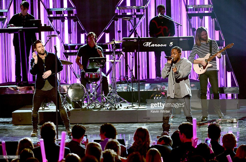 Singer Adam Levine of Maroon 5 (L) and rapper Kendrick Lamar perform onstage during the 2016 American Music Awards at Microsoft Theater on November 20, 2016 in Los Angeles, California.