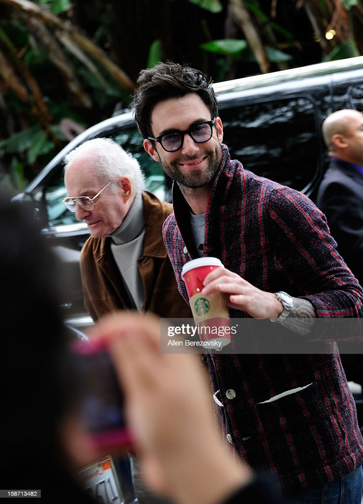 Singer <a gi-track='captionPersonalityLinkClicked' href=/galleries/search?phrase=Adam+Levine+-+Singer&family=editorial&specificpeople=202962 ng-click='$event.stopPropagation()'>Adam Levine</a> of Maroon 5 arrives at the LA Lakers game against the New York Knicks at the Staples Center on December 25, 2012 in Los Angeles, California.
