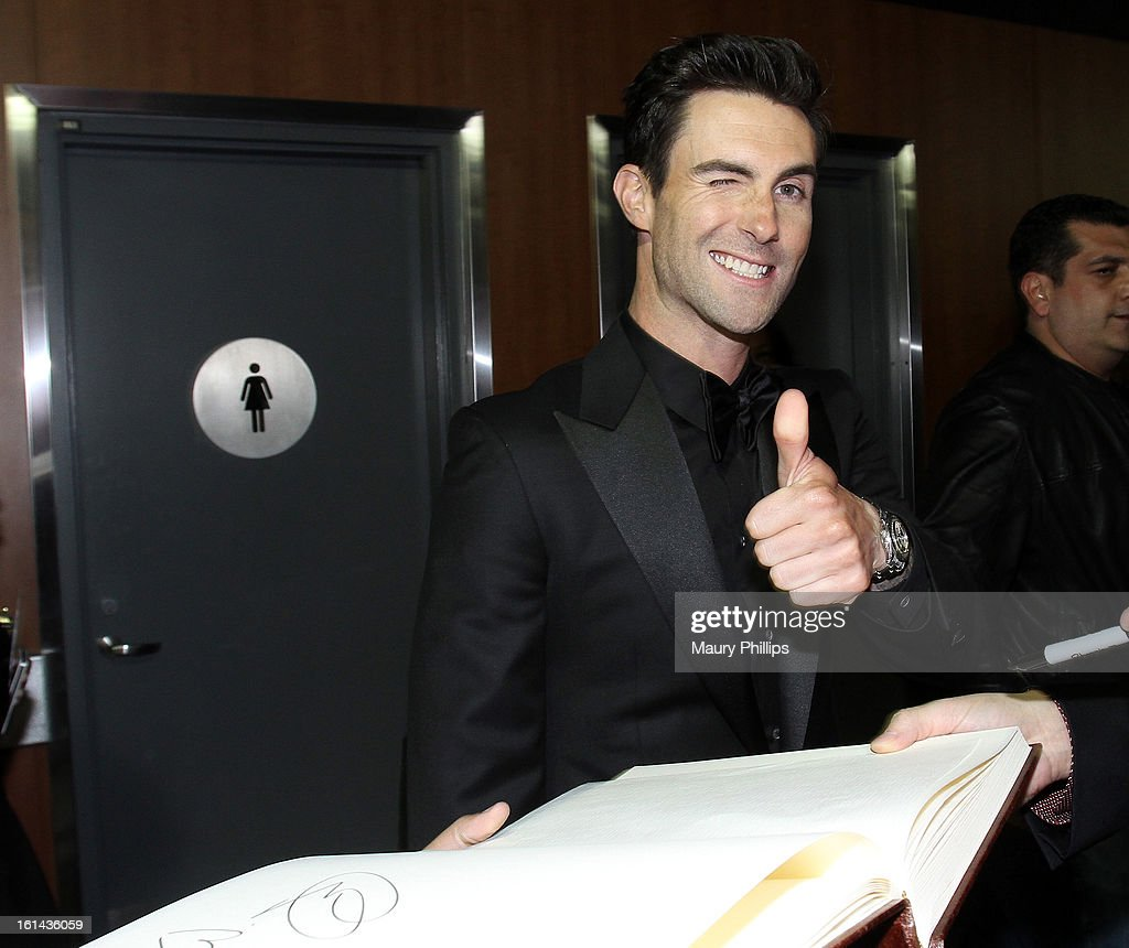 Singer <a gi-track='captionPersonalityLinkClicked' href=/galleries/search?phrase=Adam+Levine+-+Singer&family=editorial&specificpeople=202962 ng-click='$event.stopPropagation()'>Adam Levine</a> of Maroon 5 poses with the GRAMMY Charities Signing Booth during the 55th Annual GRAMMY Awards at STAPLES Center on February 10, 2013 in Los Angeles, California.