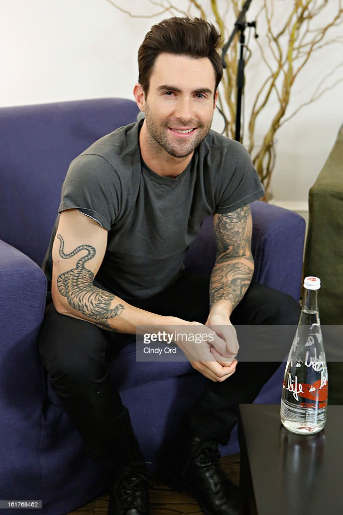 Singer <a gi-track='captionPersonalityLinkClicked' href=/galleries/search?phrase=Adam+Levine+-+Singer&family=editorial&specificpeople=202962 ng-click='$event.stopPropagation()'>Adam Levine</a> poses after being interviewed by Danielle Monaro of 'Elvis Duran and the Morning Show' at The Mercer Hotel on February 15, 2013 in New York City.