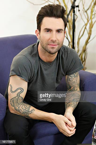 Singer Adam Levine poses after being interviewed by Danielle Monaro of 'Elvis Duran and the Morning Show' at The Mercer Hotel on February 15 2013 in...
