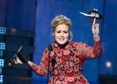 Singer Adele accepts Best Pop Solo Performance for 'Set Fire to the Rain ' onstage at the 55th Annual GRAMMY Awards at Staples Center on February 10...