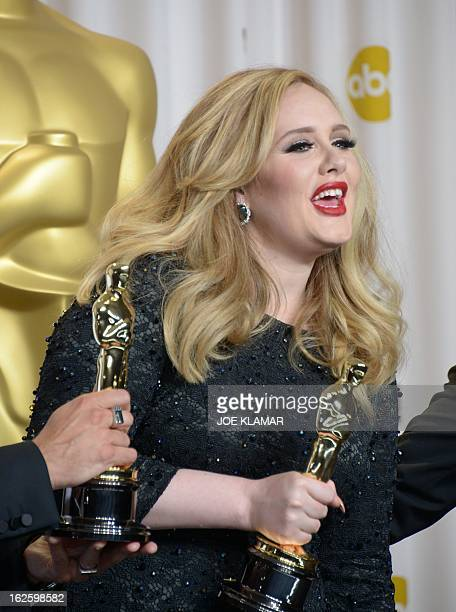 Singer Adele Adkins holds the Best Original Song Award for Skyfall from the movie 'Skyfall' in the press room during the 85 Academy Awards on...