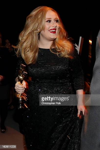 Singer Adele Adkins winner of the award for Achievement in Music Written for Motion Picture Original Song backstage during the Oscars held at the...