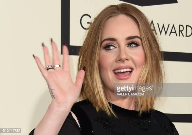 Singer Adele arrives on the red carpet during the 58th Annual Grammy Music Awards in Los Angeles February 15 2016 AFP PHOTO/ Valerie MACON / AFP /...