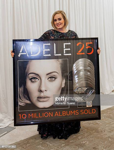 Singer Adele is presented a plaque celebrating her 10time Platinum or Diamond certification of her latest album '25' at Madison Square Garden on...
