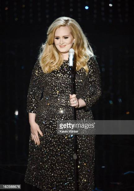 Singer Adele performs onstage during the Oscars held at the Dolby Theatre on February 24 2013 in Hollywood California