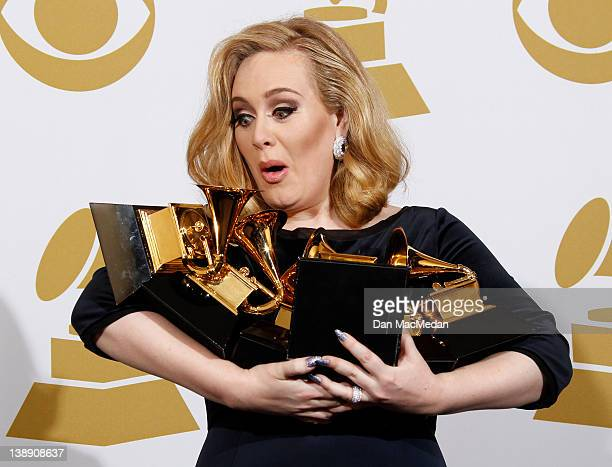 Singer Adele poses in the press room at the 54th Annual GRAMMY Awards held at the Staples Center on February 12 2012 in Los Angeles California
