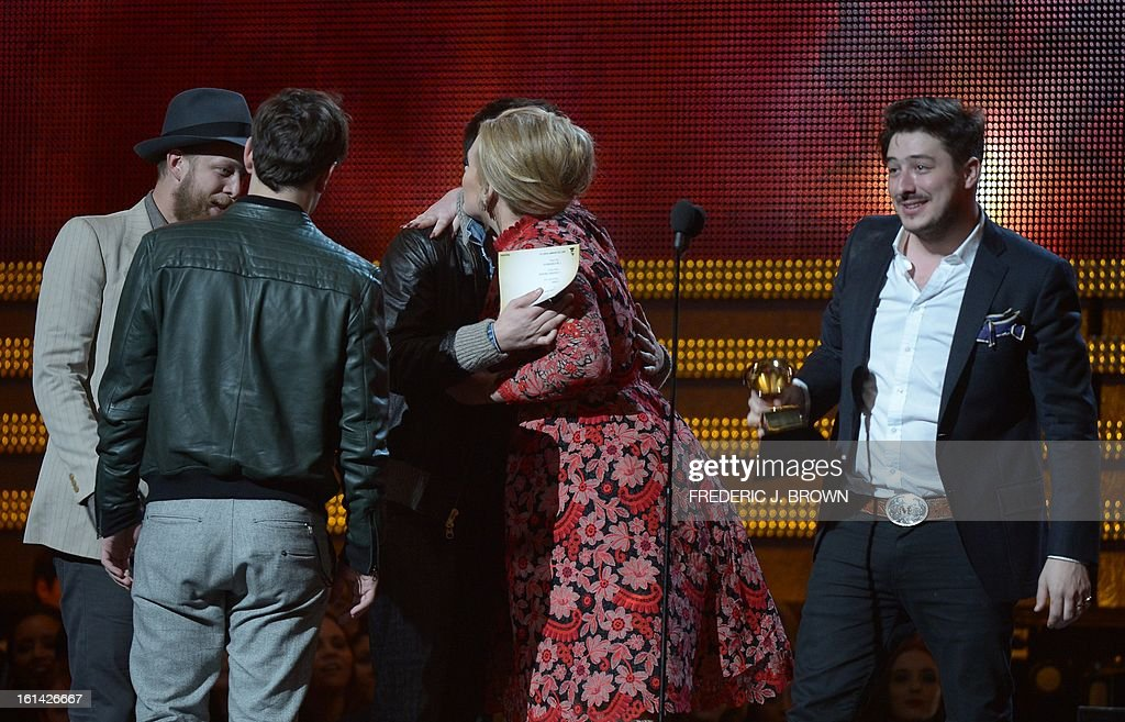 Singer Adele presents the trophy for Best Album of the Year to Mumford & Sons on stage at the Staples Center during the 55th Grammy Awards in Los Angeles, California, February 10, 2013. AFP PHOTO Joe KLAMAR