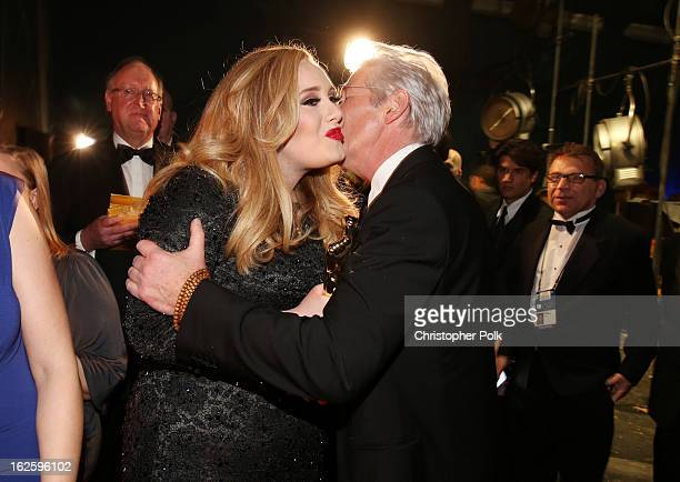 Singer Adele winner of the Best Original Song award for 'Skyfall' and actor Richard Gere backstage during the Oscars held at the Dolby Theatre on...