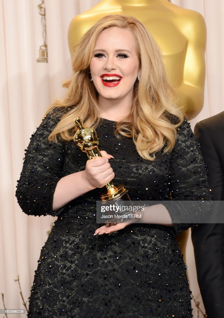 Singer <a gi-track='captionPersonalityLinkClicked' href=/galleries/search?phrase=Adele+-+Singer&family=editorial&specificpeople=4898935 ng-click='$event.stopPropagation()'>Adele</a>, winner of the Best Original Song award for 'Skyfall,' poses in the press room during the Oscars held at Loews Hollywood Hotel on February 24, 2013 in Hollywood, California.