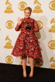 Singer Adele winner of the Best Pop Solo Performance for 'Set Fire To The Rain [Live]' poses in the press room at the 55th Annual GRAMMY Awards at...