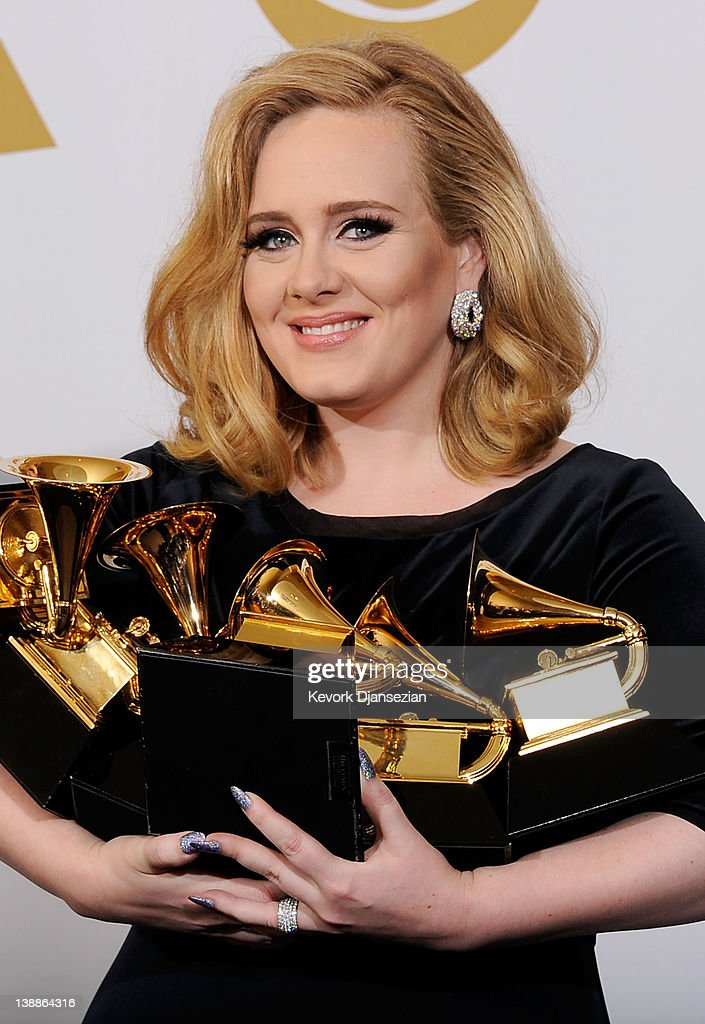 Singer <a gi-track='captionPersonalityLinkClicked' href=/galleries/search?phrase=Adele+-+Singer&family=editorial&specificpeople=4898935 ng-click='$event.stopPropagation()'>Adele</a>, winner of the GRAMMYs for Record of the Year for 'Rolling In The Deep', Album of the Year for '21', Song of the Year for 'Rolling In The Deep', Best Pop Solo Performance for 'Someone Like You', Best Pop Vocal Album for '21' and Best Short Form Music Video for 'Rolling In The Deep', poses in the press room at the 54th Annual GRAMMY Awards at Staples Center on February 12, 2012 in Los Angeles, California.