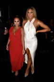 Singer Adrienne Bailon and Tamar Braxton attend the BET AWARDS '14 at Nokia Theatre LA LIVE on June 29 2014 in Los Angeles California