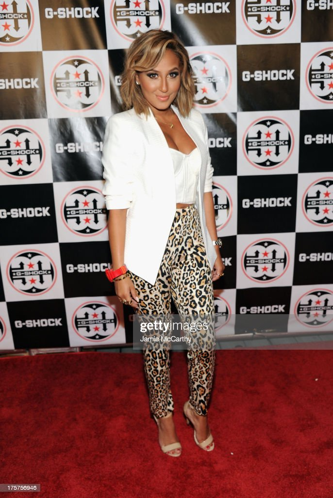 Singer Adrienne Bailon attends G-Shock Shock The World 2013 at Basketball City on August 7, 2013 in New York City.
