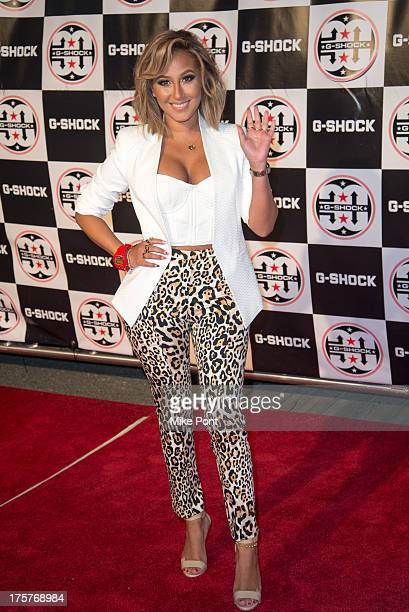 Singer Adrienne Bailon attends GShock Shock The World 2013 at Basketball City Pier 36 South Street on August 7 2013 in New York City