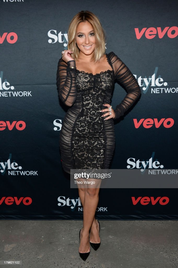 Singer <a gi-track='captionPersonalityLinkClicked' href=/galleries/search?phrase=Adrienne+Bailon&family=editorial&specificpeople=540286 ng-click='$event.stopPropagation()'>Adrienne Bailon</a> attends the VEVO and Styled To Rock Celebration Hosted by Actress, Model and 'Styled to Rock' Mentor Erin Wasson with Performances by Bridget Kelly & Cazzette on September 5, 2013 in New York City.