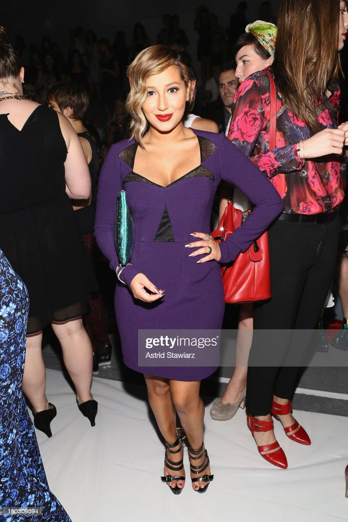 Singer Adrienne Bailon poses backstage with TRESemme at the Nanette Lepore fashion show during Mercedes-Benz Fashion Week Spring 2014 at The Stage at Lincoln Center on September 11, 2013 in New York City.