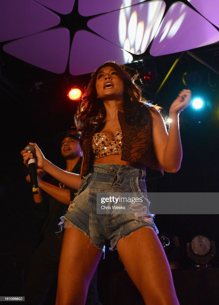 Singer Agnes Monica performs during mPowering Action, a global mobile youth movement at Grammy Week launch, featuring performances by Timbaland and Avicii at The Conga Room at L.A. Live on February 8, 2013 in Los Angeles, California.
