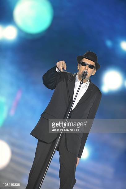 """Singer Alain Bashung reacts on stage as he receives Best Male Artist of the Year Award during the 'Music's Victories"""" in Paris France on February..."""