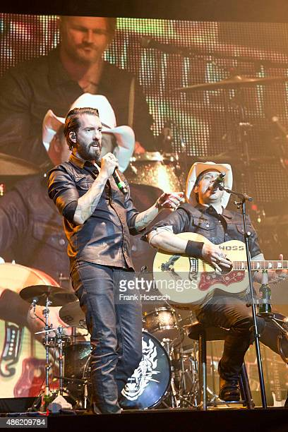 Singer Alec Voelkel and Sascha Vollmer of the German band The Bosshoss perform live during The Stars For Free 2015 concert at the Kindlbuehne...