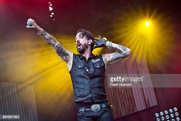 Singer Alec Voelkel of the German band The Boss Hoss performs live during a concert at the Zitadelle Spandau on July 29 2016 in Berlin Germany