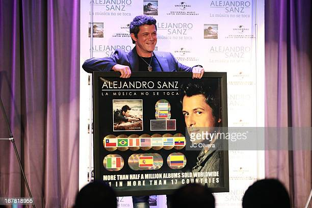 Singer Alejandro Sanz attends a press conference as he donates a guitar from 2002 Grammys and 9/11 Latin Grammys to Grammy Museum at The GRAMMY...