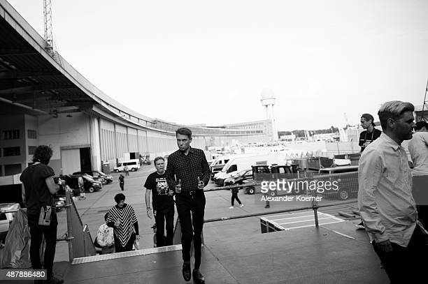 Singer Alex Kapranos walks on stage before the concert of FFS during the first day of the Lollapalooza Berlin music festival at Tempelhof Airport on...