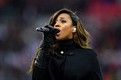 Singer Alexandra Burke performs the national anthem prior to kickoff during the Women's International Friendly match between England and Germany at...