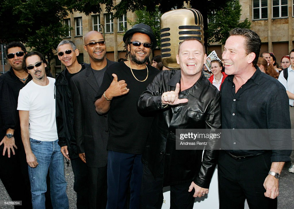 Singer Ali Campbell (2nd R), his brother Robin Campbell (R) and their band UB40 attend the German Radio Awards 2005 at the Tempodrom Hall September 2, 2005 in Berlin, Germany.