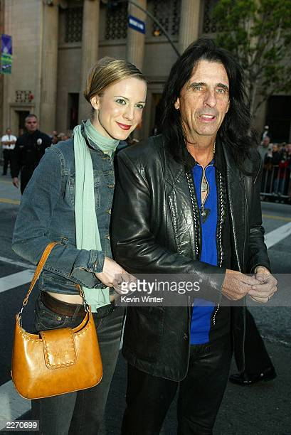 Singer Alice Cooper and his daughter Calico arrives at the premiere of 'X2 XMEN UNITED' at the Chinese Theatre on April 28 2003 in Los Angeles...