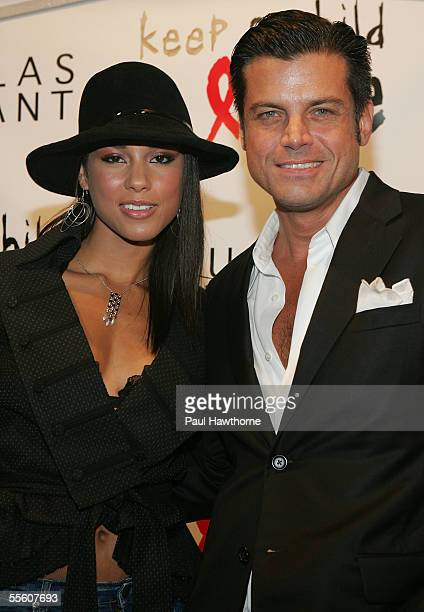 Singer Alicia Keys and Douglas Hannant attend the Keep a Child Alive Kick Off Black Ball at Cain during Olympus Fashion Week September 15 2005 in New...