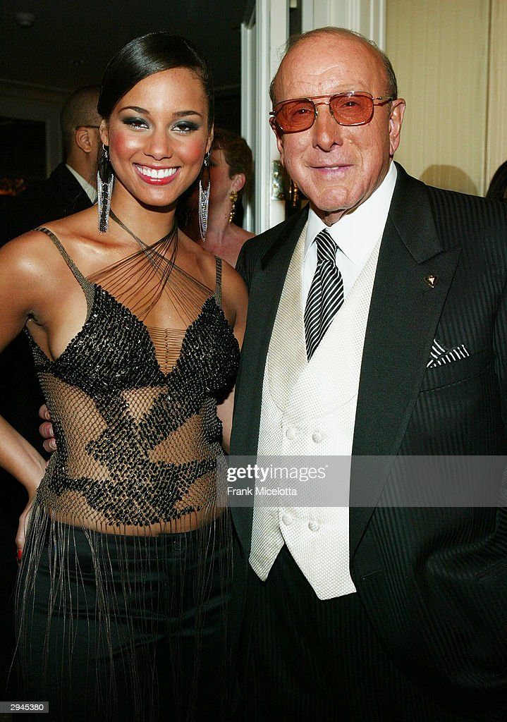 Singer <a gi-track='captionPersonalityLinkClicked' href=/galleries/search?phrase=Alicia+Keys&family=editorial&specificpeople=169877 ng-click='$event.stopPropagation()'>Alicia Keys</a> and music mogul <a gi-track='captionPersonalityLinkClicked' href=/galleries/search?phrase=Clive+Davis&family=editorial&specificpeople=209314 ng-click='$event.stopPropagation()'>Clive Davis</a> attend <a gi-track='captionPersonalityLinkClicked' href=/galleries/search?phrase=Clive+Davis&family=editorial&specificpeople=209314 ng-click='$event.stopPropagation()'>Clive Davis</a>' legendary Pre-Grammy party at the Beverly Hills Hotel on February 7, 2004 in Beverly Hills, California.