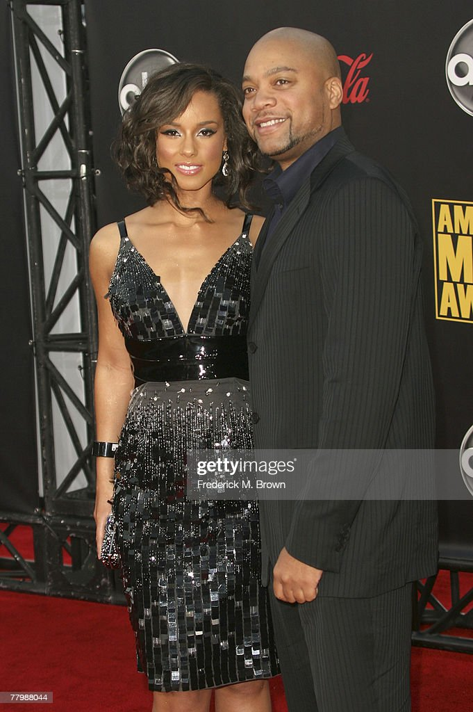 Singer Alicia Keys (L) and producer Kerry 'Krucial' Brothers arrive at the 2007 American Music Awards held at the Nokia Theatre L.A. LIVE on November 18, 2007 in Los Angeles, California.