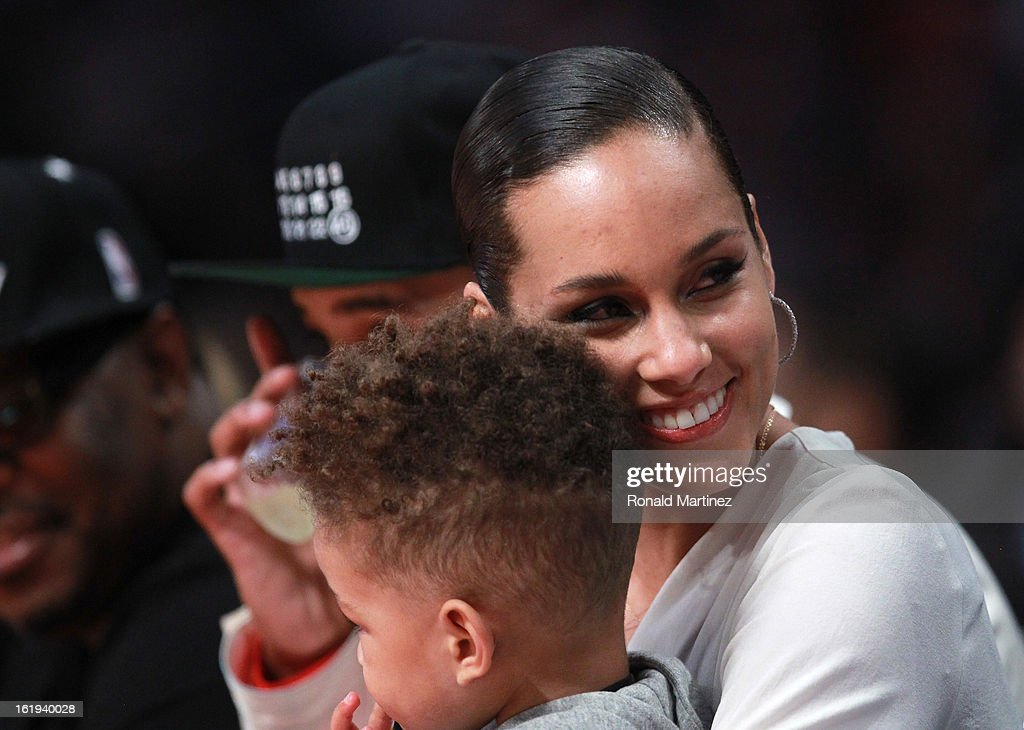 Singer Alicia Keys and son Egypt Daoud Dean during the 2013 NBA All-Star game at the Toyota Center on February 17, 2013 in Houston, Texas.