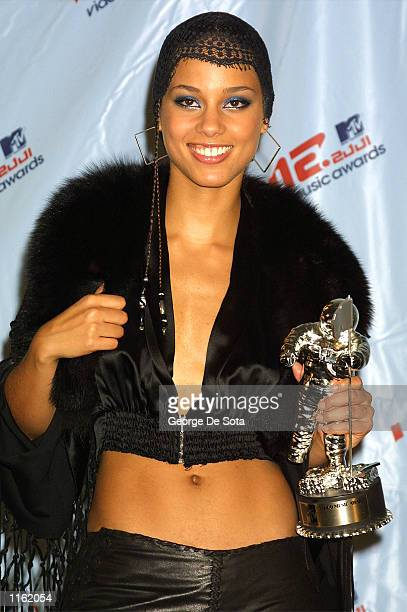 Singer Alicia Keys holds her best new artist award at the MTV Video Music Awards September 6 2001 in New York City