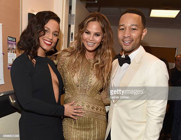 Singer Alicia Keys model Chrissy Teigen and singer John Legend pose backstage during 'Sinatra 100 An AllStar GRAMMY Concert' celebrating the late...