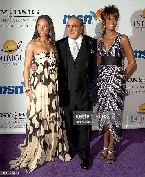 Singer Alicia Keys music producer Clive Davis and singer Whitney Houston arrive to the 'Clive Davis PreGrammy Party' at the Beverly Hilton Hotel on...