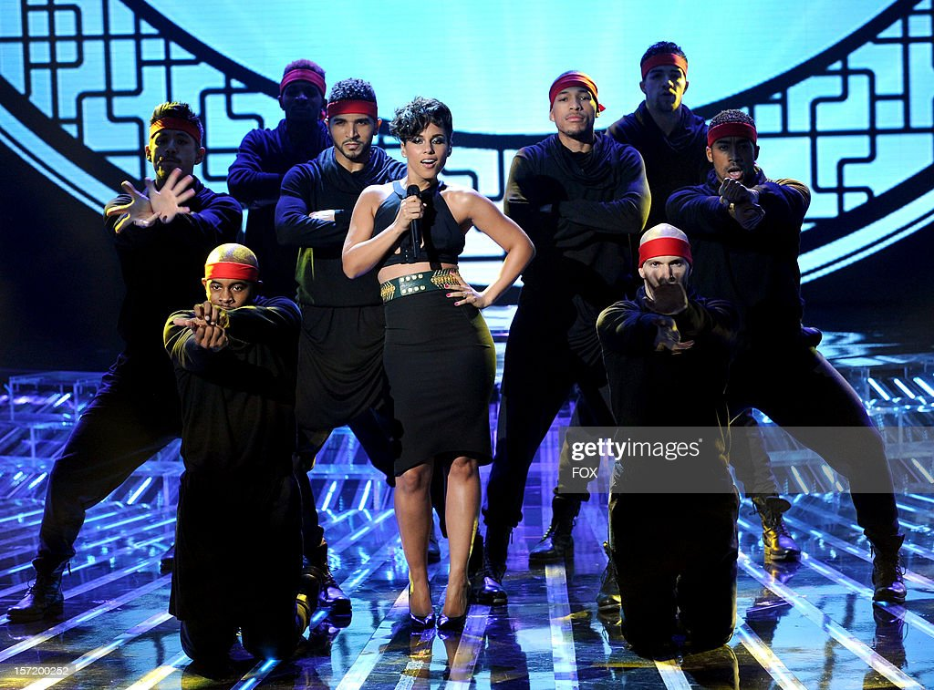 Singer <a gi-track='captionPersonalityLinkClicked' href=/galleries/search?phrase=Alicia+Keys&family=editorial&specificpeople=169877 ng-click='$event.stopPropagation()'>Alicia Keys</a> performs onstage at FOX's 'The X Factor' Season 2 Top 8 to 6 Live Elimination Show on November 29, 2012 in Hollywood, California.