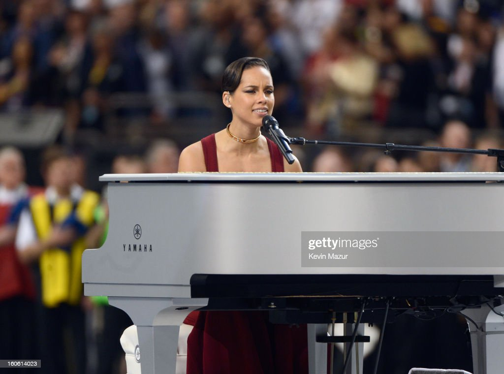 Singer <a gi-track='captionPersonalityLinkClicked' href=/galleries/search?phrase=Alicia+Keys&family=editorial&specificpeople=169877 ng-click='$event.stopPropagation()'>Alicia Keys</a> performs The Star-Spangled Banner during the Pepsi Super Bowl XLVII Pregame Show at Mercedes-Benz Superdome on February 3, 2013 in New Orleans, Louisiana.