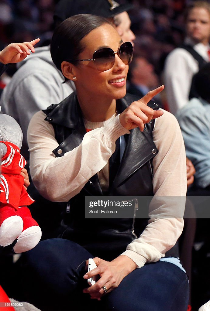 Singer Alicia Keys points during the Sprite Slam Dunk Contest part of 2013 NBA All-Star Weekend at the Toyota Center on February 16, 2013 in Houston, Texas.